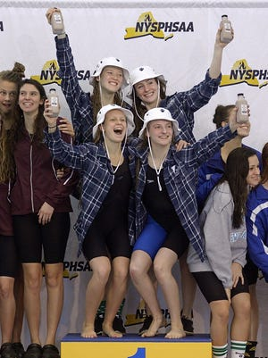 Pittsford's Lindsay Stone, top left, Katie Smith, Becca Evans and Emma Corby celebrate their win in the 400-yard freestyle relay during the NYSPHSAA Girls Swimming & Diving Championships held at Ithaca College on Nov. 21, 2015.
