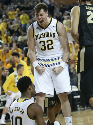 University of Michigan Wolverines Ricky Doyle celebrates a basket by Derrick Walton Jr. during second half action against the Purdue Boilermaker on Saturday, February 13, 2016 at Crisler Center in Ann Arbor.