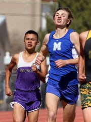 Kirtland Central's Kashon Harrison, left, and Mancos, Colo.'s, Ro Paschal run for the finish of the 1600-meter race on Saturday at Hutchison Stadium.