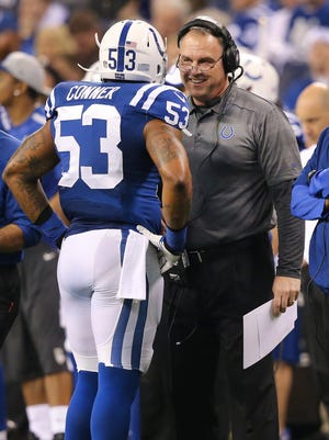 Indianapolis Colts Kavell Conner talks with defensive coordinator Greg Manusky in the second half of Sundays game on December 29, 2013. The Colts beat the Jaguars 30-10.