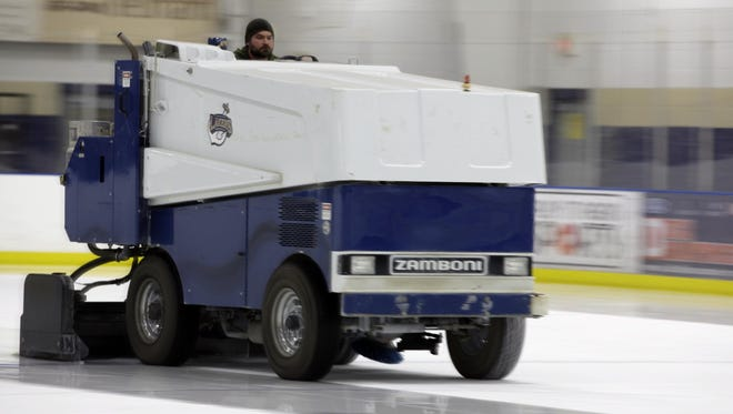 A Zamboni smoothes the surface of the ice at a Sheboygan rink.