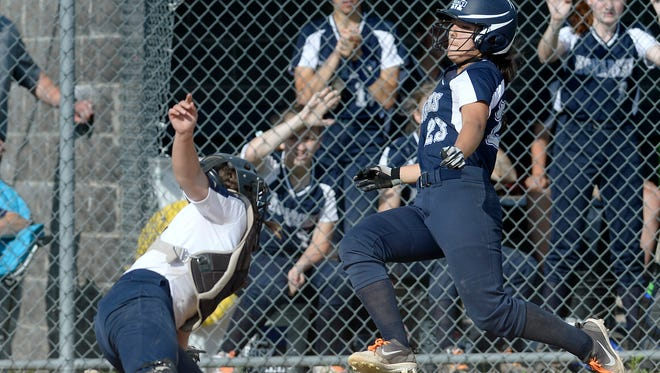 Mercy's Keelan Crowley, right, beats the tag of Pittsford Sutherland's Katie Mullin for the Monarchs' 10th run during the Section V Class A qualifier at Wayne High School, Thursday, May 31, 2018. Mercy advanced to the Class A Wester Regional with a 11-0 win over Pittsford Sutherland.