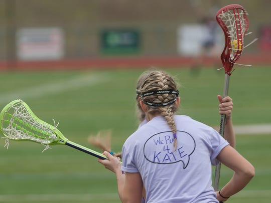 Cherokee Lacrosse player Magan Everett wears a dedication t-shirt for team-mate Katie Bednarek, who was recently diagnosed with brain cancer. 03.28.14