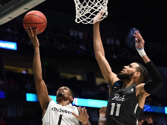Cincinnati Bearcats guard Jacob Evans (1) drives to the basket against Nevada in the second round of the 2018 NCAA Tournament at Bridgestone Arena.