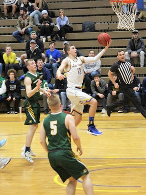 Justin Fischer (13) of Lake Superior State drives to the basket during a game this past season. Fischer was named the Lakers' Most Improved player.