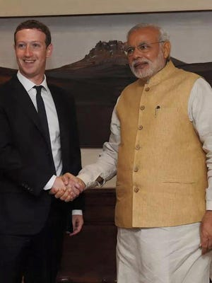 Facebook CEO Mark Zuckerberg shaking hands with Indian Prime Minister Prime Minister Narendra Modi.