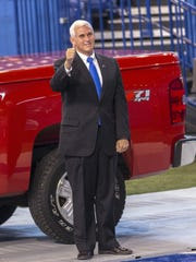 Republican nominee for Indiana governor Mike Pence, steps onto the field briefly at Lucas Oil Stadium before tonight's event to check on the crowd and staging. Indiana Republican Party at Lucas Oil Stadium, Indianapolis, Ind., Tuesday, November 6, 2012. (Matt Dial / For The Star)
