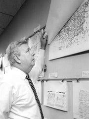WHEC-TV (Channel 10) meteorologist John Hambleton checks his charts before a 6 p.m. forecast.