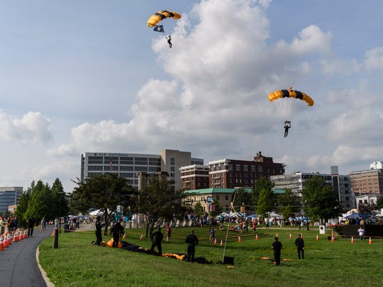 Members of the Golden Knights – the United States Army Parachute team – prepare to land near the Four Freedoms monument during Shriner's Fest in downtown Evansville, Ind., Thursday, June 28, 2018.
