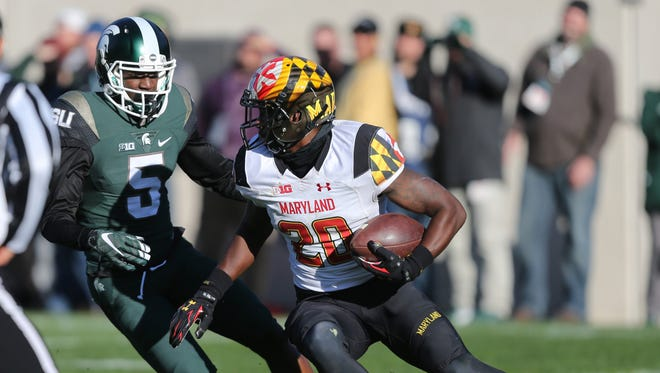 Maryland running back Anthony Nixon, right, is unable to evade Michigan State's Andrew Dowell (5) on Nov. 14, 2015, at Spartan Stadium in East Lansing.