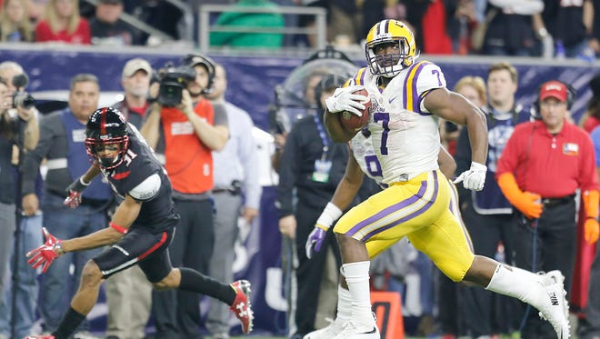FILE -- LSU Tigers running back Leonard Fournette (7) catches the ball and runs for a touchdown against the Texas Tech Red Raiders in the second quarter at NRG Stadium.