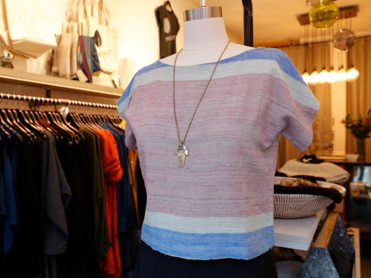 """A """"peace silk"""" cropped top is displayed on a mannequin"""