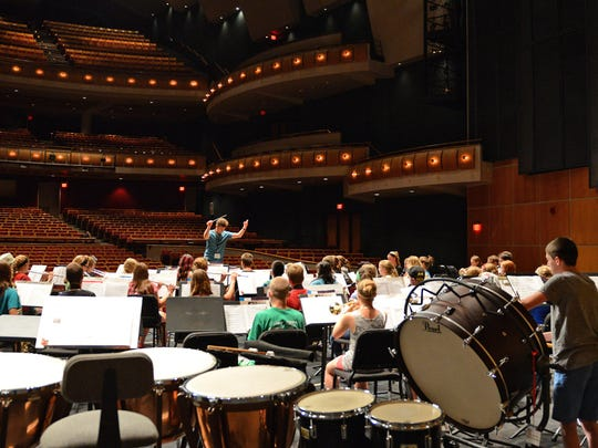 Scott Wright directs ninth grade band rehearsal at the Weidner Center during summer music camp at the University of Wisconsin-Green Bay.