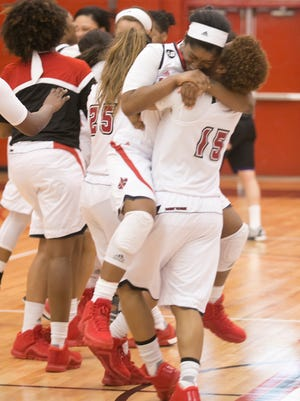 The Ragin Cajuns celebrate after winning the WBI Championship Game on Saturday afternoon over Weber State.John Rowland/Special to the Advertiser