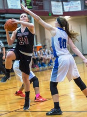 Milford's Megan Wallace goes up for the shot against Western's Ericka VanMaele.