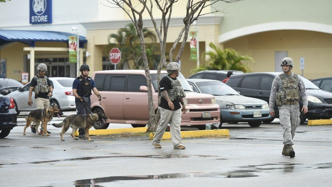 The U.S. Airforce Security Forces K-9 Unit respond to a bomb threat at the Agana Shopping Center in Hagatna on Jan. 31.