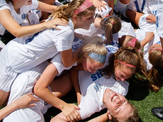Brookfield Central girls pile on top of teammate Jenny