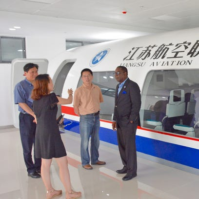 Officials with the newly created Jiangsu Aviation Technical College in Zhenjiang, China, show MTSU President Sidney A. McPhee a Boeing 737 cabin simulator during a tour on Wednesday, July 20.
