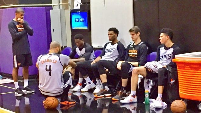 Tyson Chandler sits on a basketball during practice on Tuesday, his first since the passing of his mother.