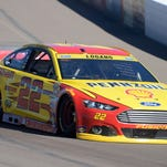 Joey Logano races during the Quicken Loans Race for Heroes 500 on Sunday. Logano is one of four drivers remaining in the Chase for the Cup.