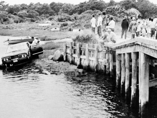 Sen. Ted Kennedy's car is pulled from water after he