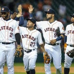 Astros second baseman Jose Altuve (27) celebrates with teammates after the Astros defeated the Seattle Mariners 11-4 at Minute Maid Park. Mandatory Credit: Troy Taormina-USA TODAY Sports