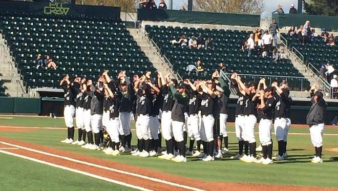The Oregon baseball team celebrates its victory Sunday against California at PK Park in Eugene.