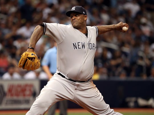 New York Yankees starting pitcher CC Sabathia (52) throws a pitch during the third inning against the Tampa Bay Rays at Tropicana Field.