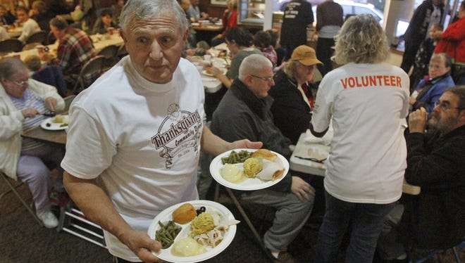 Jay Grant helps serve free turkey dinners at the Covered Bridge Cafe's annual Community Thanksgiving Dinner in Stayton, Wednesday, Nov. 23, 2011.