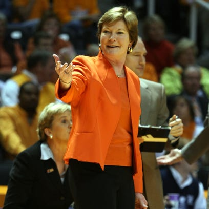 Pat Summitt shares a laugh with a referee during the