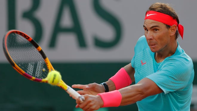 Rafael Nadal plays a shot against Diego Schwartzman during Friday's French Open semifinal in Paris.