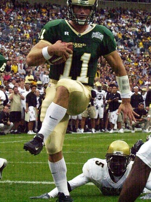 CSU quarterback Bradlee Van Pelt, a two-time Mountain West Offensive Player of the Year, high-steps his way into the end zone for a touchdown during a 2003 game against the University of Colorado in Denver.