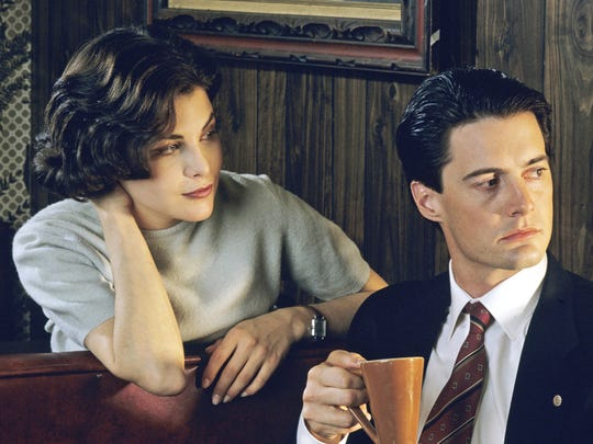 "Sherilynn Fenn is mighty intrigued by FBI agent Dale Cooper (Kyle MacLachlin), who has come to investigate a bizarre murder in ""Twin Peaks."" He seems more interested in a good cup of coffee."