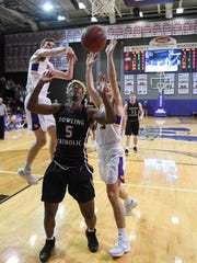 Waukee's Dylan Jones (4) swats down the shot of Dowling's
