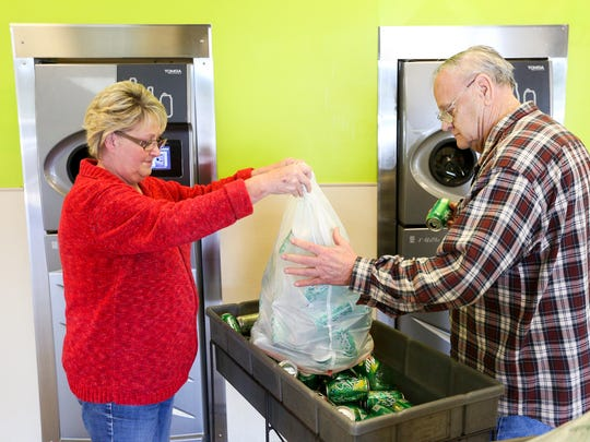 Wanda and George Stephenson begin loading cans at the BottleDrop Redemption Center on 4815 Commercial St. SE on Tuesday, March 21, 2017, in Salem, Ore. The two said it had been a while since they came in, and had several bags of cans to drop off.