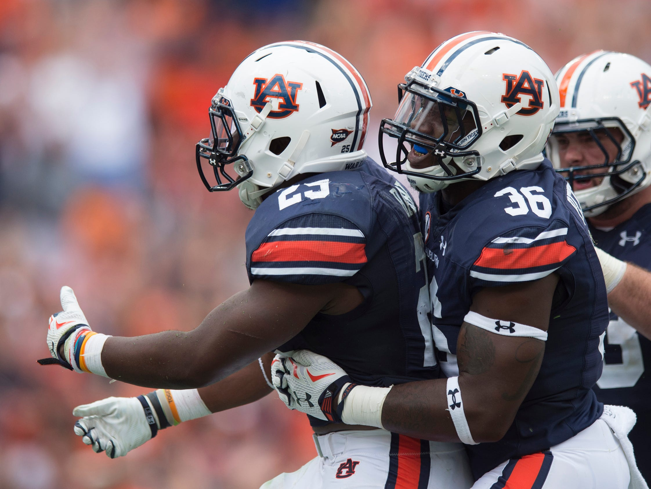 Auburn Tigers running back Peyton Barber (25) celebrates with Auburn Tigers fullback Kamryn Pettway (36) after scoring touchdown during overtime of the NCAA Auburn vs. Jacksonville State on Saturday, Sept. 12, 2015, in at Jordan-Hare Stadium in Auburn, Ala.