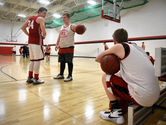 Players talk during a break in practice Monday at Annandale