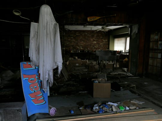 Scott and Amy Kelly, owners of Mad Hatter in Sea Bright, tour the property, which was destroyed by Sandy, Friday June 3, 2016. The owners will go before the planning board for the ninth time to finally get approval to start the rebuild later this month. A ghost decoration from a Halloween party before Sandy still hangs.