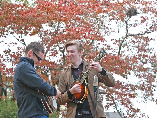 Charles Wood (left) and Kaleb Hanks, members of NitroGrass bluegrass, play during the Pendleton Fall Harvest Festival in the town square.