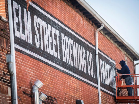 In this file photo, Elm Street Brewing Co. prepares for its grand opening in the McKinley Neighborhood.