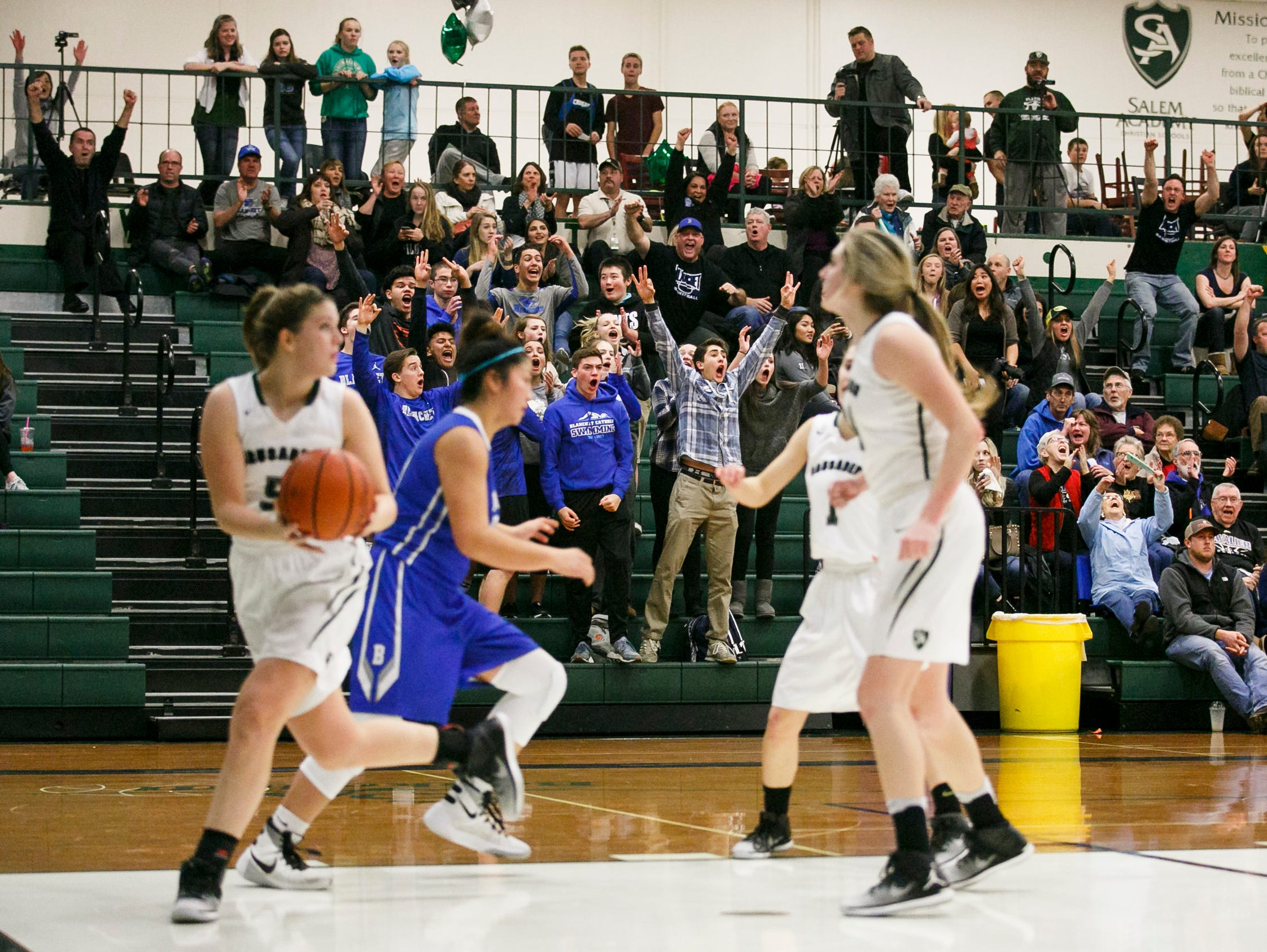 Blanchet fans cheer as Sophia Poole (15) scores a three-pointer in the final minute of a game against Salem Academy on Wednesday, Jan. 4, 2017 at Salem Academy. No. 4-ranked Blanchet defeated No. 1 Salem Academy 42-40 in the PacWest Conference game.