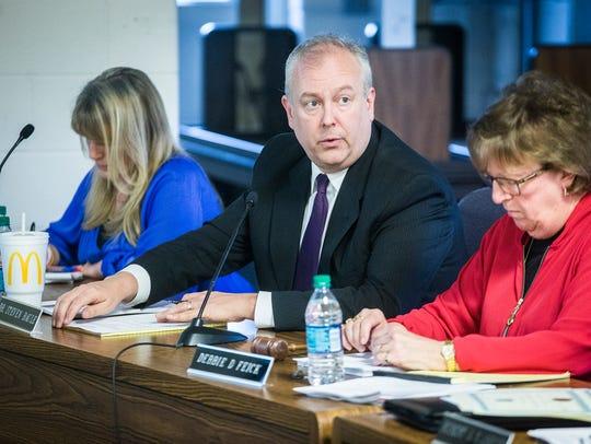 Dr. Steve Baule speaks during a school board meeting