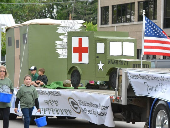 """The television show """"MASH"""" was the theme of the Bellin Health float, which won first place in the Oconto Copperfest Parade on June 9. The """"Cheers"""" float came in second place, with Pure Romance by Janet Van's Sex in the City float in third."""