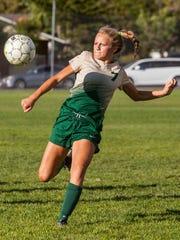 Snow Canyon striker Heidi Smith (7) attempts a shot