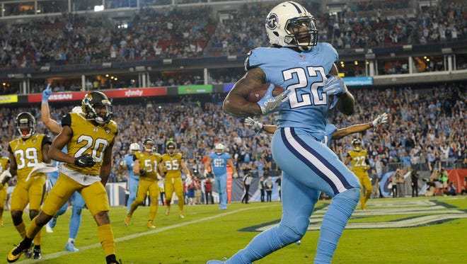Titans running back Derrick Henry (22) leaves Jaguars cornerback Jalen Ramsey (20) behind as he scores the team's second touchdown on Oct. 27, 2016.