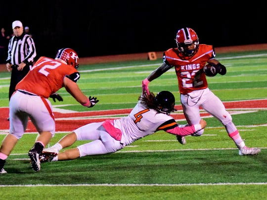Nak'emon Williams (22) tries to wiggle loose against Loveland.