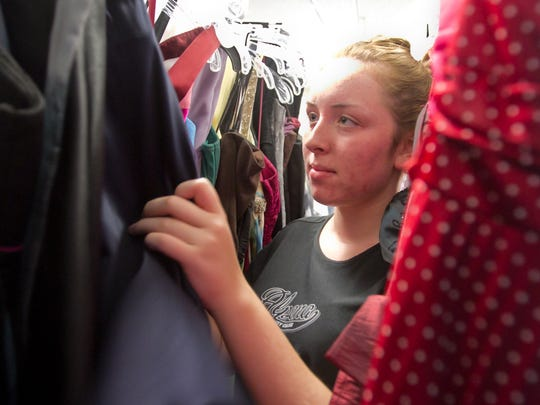 Amanda Hutchinson looks at homecoming dresses at a Cinderella's Closet boutique event Friday, Sept. 15, 2017, when she was a 15-year-old South Lyon East sophomore.