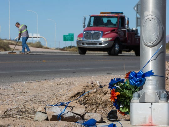 A memorial for retired Las Cruces police officer J.R. Stewart, set up Tuesday Nov. 28, 2017, along Las Alturas Drive, marks the spot where Stewart was struck by a vehicle fleeing law enforcement Monday night. Stewart had been riding his motorcycle.