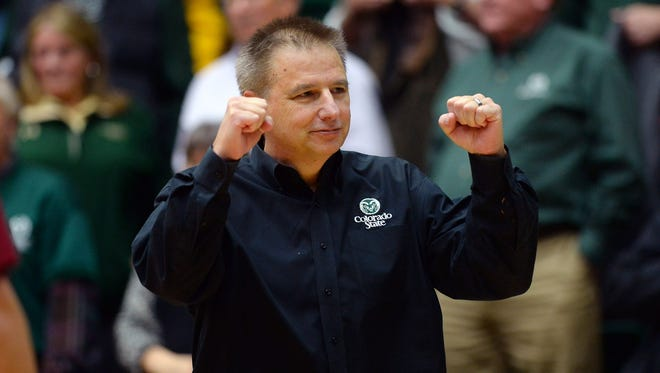 CSU coach Larry Eustachy celebrates a double-overtime win Feb. 10 over Boise State at Moby Arena.