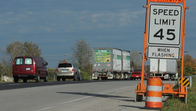 Signs warn of possible construction on Interstate 70 in Wayne County.